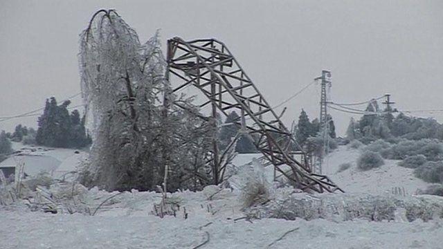 Collapsed pylon in snow