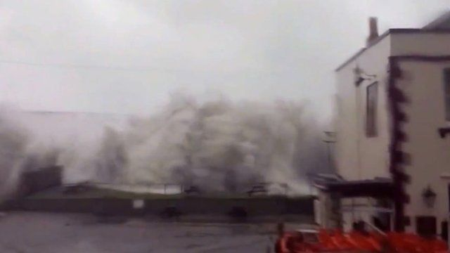 Waves overtopped Chesil Beach by the Little Ship pub in Victoria Square, Portland