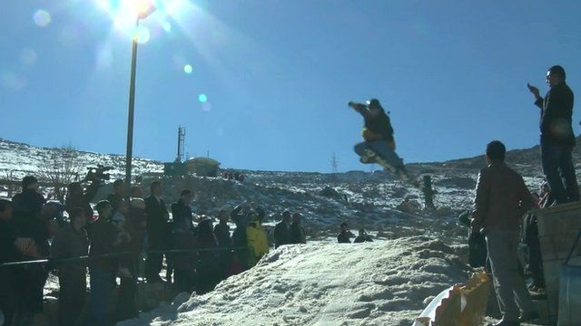 Skier goes over jump