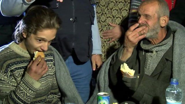 Two people eating