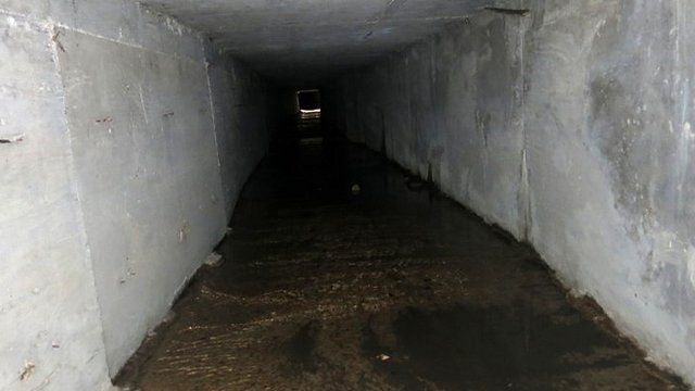 "An interconnected tunnel in Mexico's drainage system that Joaquin ""Shorty"" Guzman used to evade the authorities"