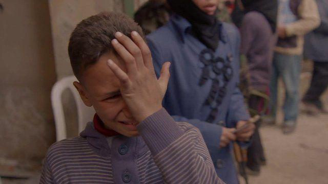 Syrian boy in Yarmouk camp