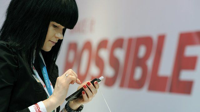 Woman holding mobile phone at Mobile World Congress