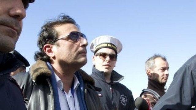 Captain Schettino in Giglio port after boarding the wreck of the Costa Concordia