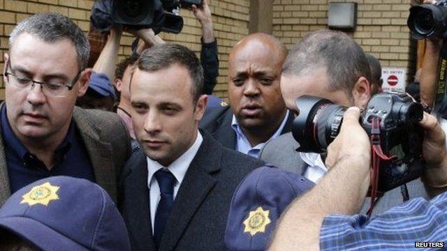 Oscar Pistorius leaving court