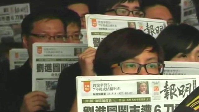 Protesters demanding an investigation into attack on Kevin Lau