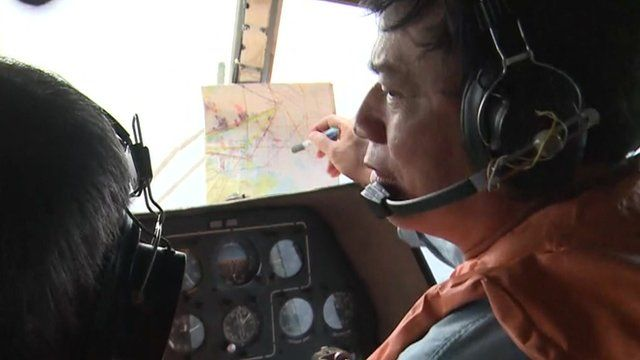 Pilot looks out of the helicopter window