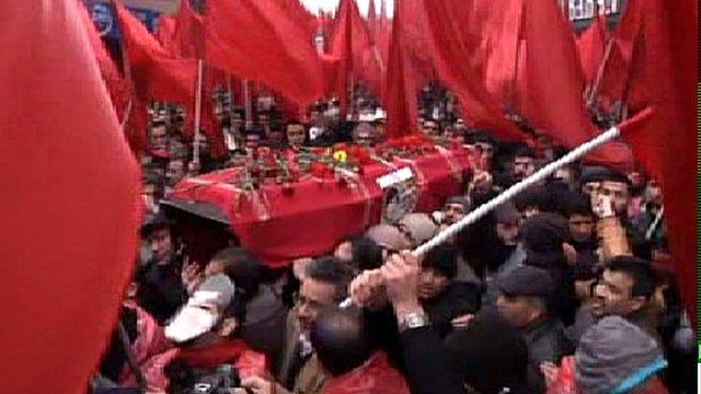 Berkin Elvan's coffin is carried through the streets of Istanbul