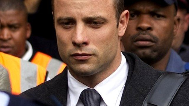 Oscar Pistorius, centre, leaves the high court in Pretoria, South Africa, on 11 March