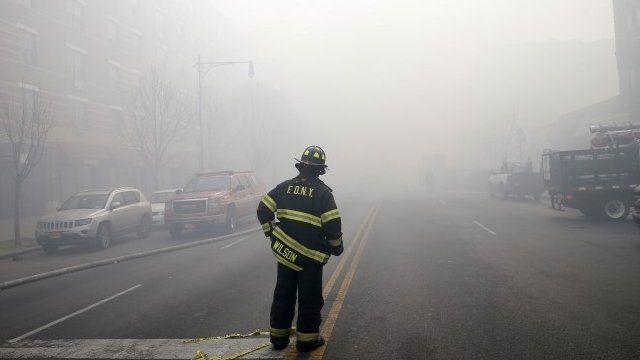 A firefighter surrounded by smoke