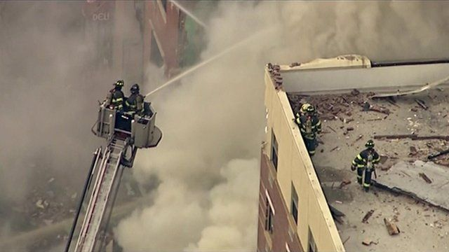 Firefighters at the scene of an explosion in New York
