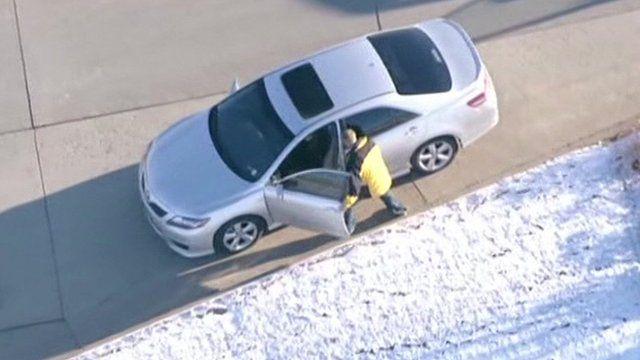 A man stealing a car