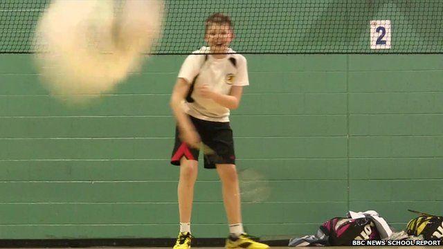 Boy on badminton court