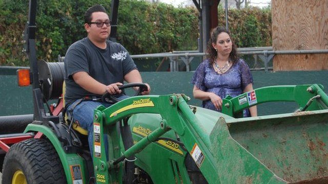 Nathan Talavera drives a tractor with supervision from teacher Jessica Fernandes