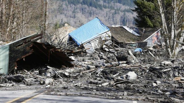 A landslide and structural debris blocks Highway 530 near Oso, Washington