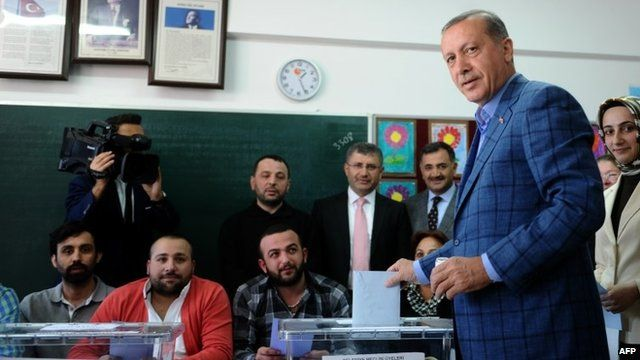 Prime Minister Recep Tayyip Erdogan casts his ballot