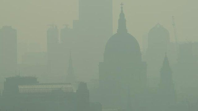 St. Paul's Cathedral is seen among the skyline through the smog in central London on April 22, 2011