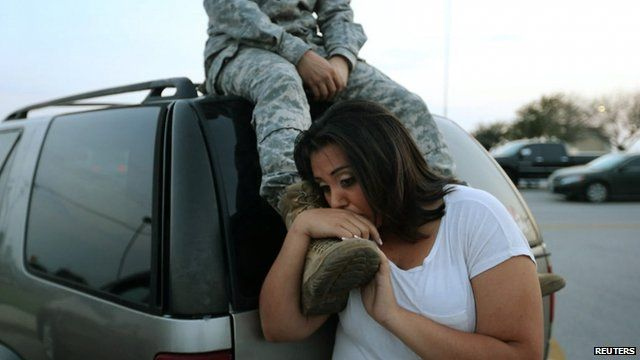 Luci Hamlin and her husband Specialist Timothy Hamlin wait to get back to their home on base at Fort Hood after a soldier shot dead four colleagues there