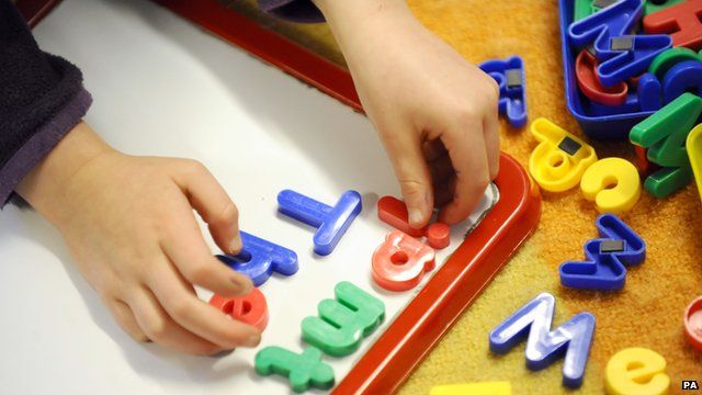 Child playing with magnetic letters
