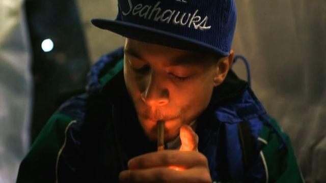 Man smokes a joint a pro-marijuana gathering in Seattle, Washington