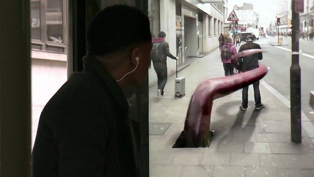 A commuter sees an optical illusion of a pedestrian being grabbed by a monster
