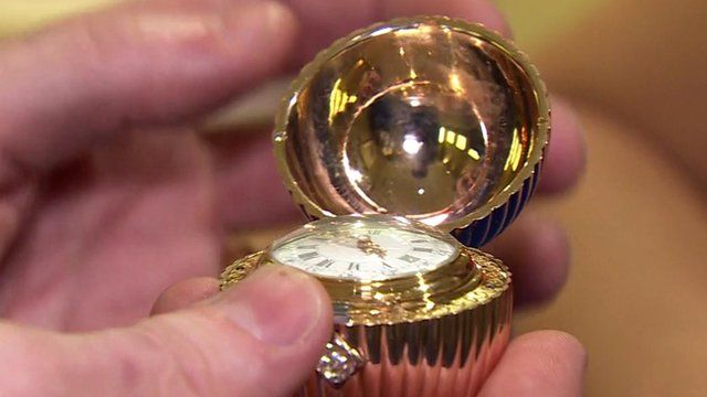Faberge egg open to reveal watch face