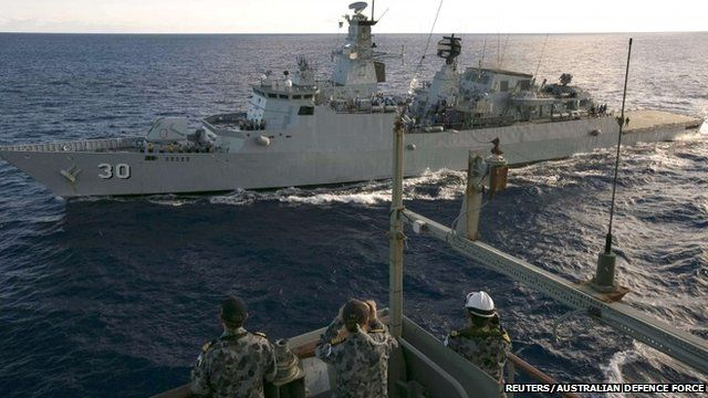 Crew aboard the Australian Navy ship HMAS Success look over to the Royal Malaysian Navy ship KD LEKIU during a Replenishment at Sea evolution in the southern Indian Ocean