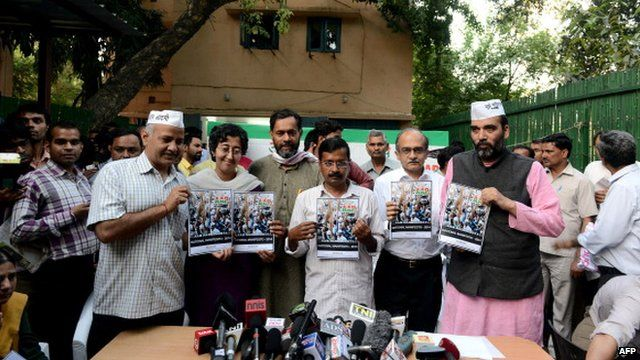 Leaders of Aam Aadmi Party holding their manifesto