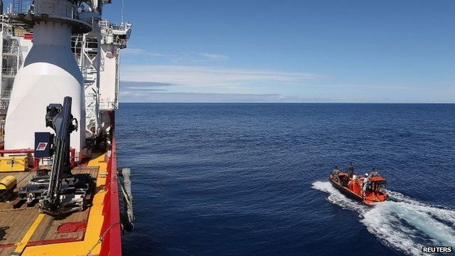 Ocean Shield (L) and fast response craft (R)
