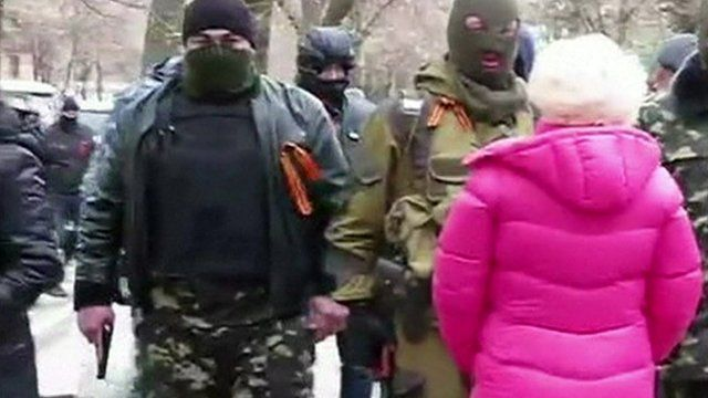 Armed men dressed in camouflage clothing