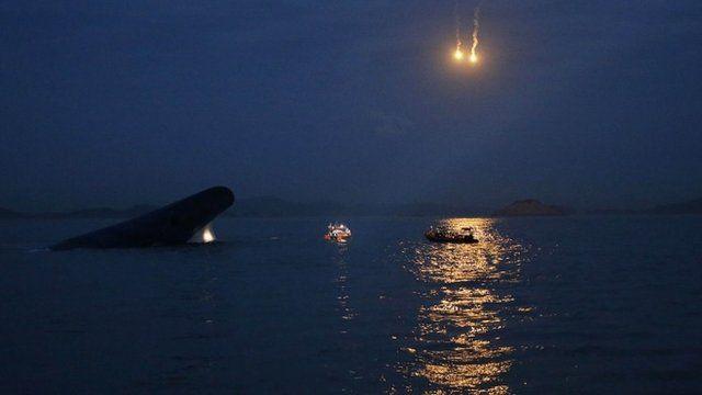 Teams scour sea in the dark