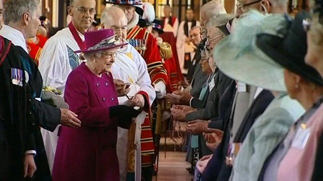 The Queen presenting the specially-minted coins to 176 recipients