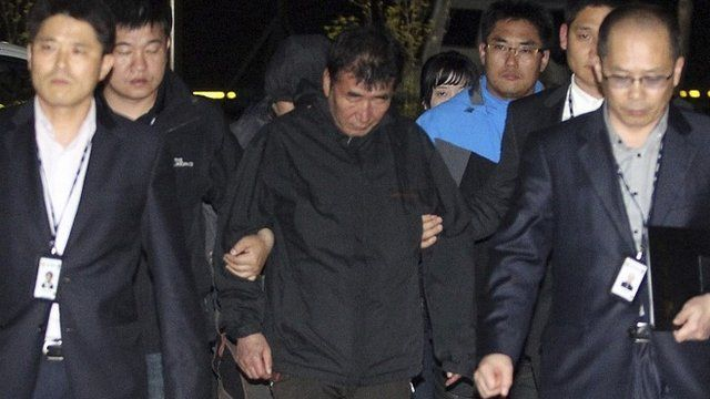 Captain Lee Jun-Seok being escorted into court in Mokpo