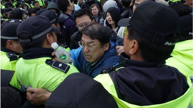 Relatives of missing passengers from the sunken ferry scuffle with police
