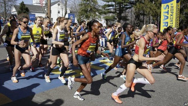 Elite women runners leave the start line of the 118th Boston Marathon on 21 April 2014