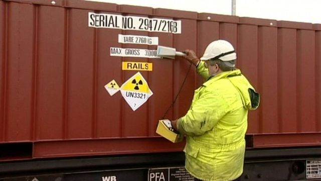 A worker checks radiation levels at Drigg nuclear waste store