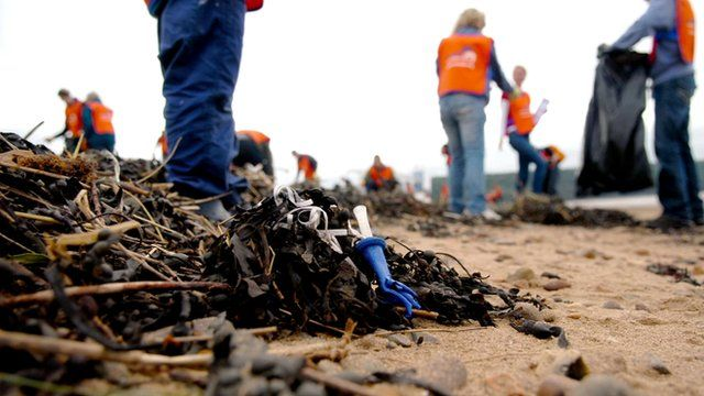 Volunteers cleaning up a beach
