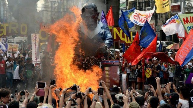 Protesters burn a US President Barack Obama effigy during an anti-US protest in Manila