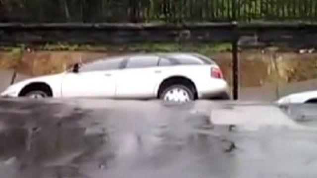 Car slips into sinkhole