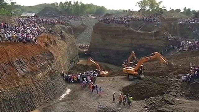 Mechanical diggers at the sight of the mine collapse in Colombia