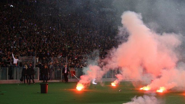 Napoli fans throw flares before the TIM Cup final match between ACF Fiorentina and SSC Napoli at Olimpico Stadium on May 3, 2014 in Rome