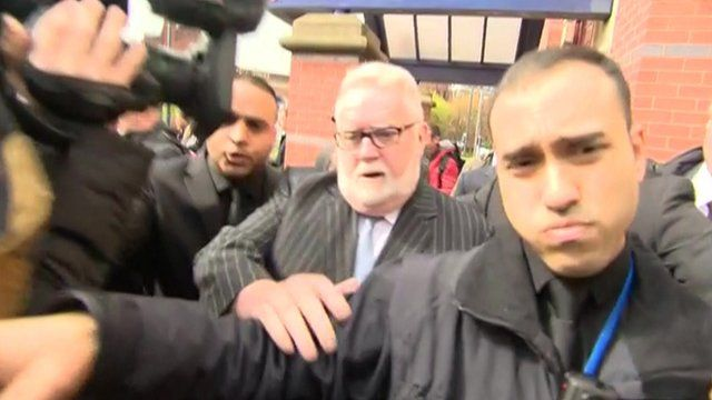 Paul Flowers leaving Leeds Magistrates' Court