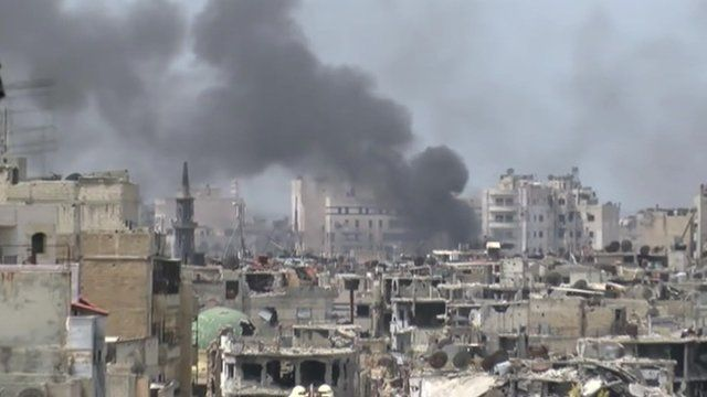 Homs skyline with smoke coming from a building