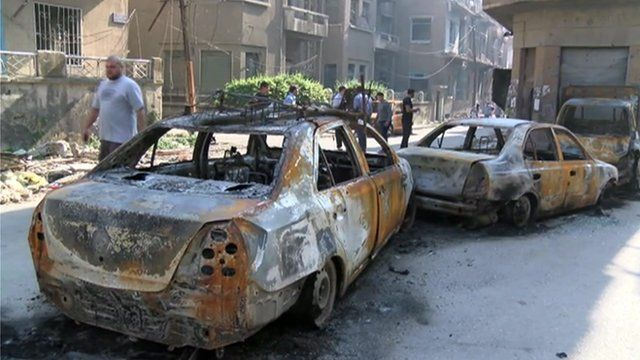 Burnt out cars in Homs