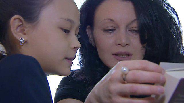 Resident of Donetsk reading to her daughter in Ukrainian