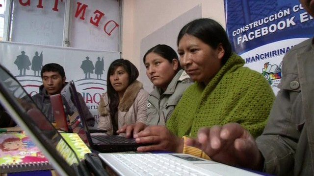 Bolivians working on laptop computers