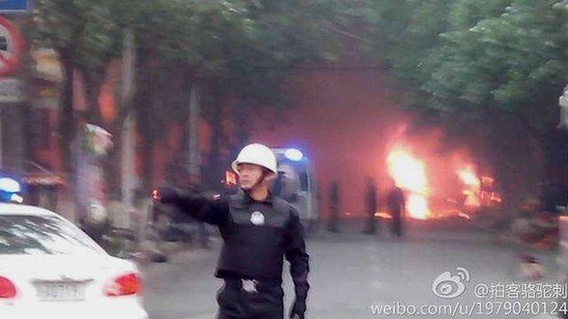 Police near presumed scene of attack in Urumqi (22 May)