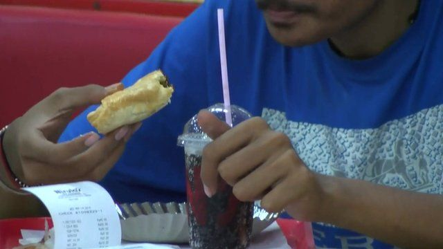 Man eating fast food in India