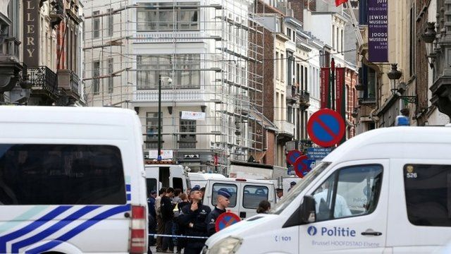 Policemen close the access of the scene of a shooting near the Jewish Museum in Brussels, on May 24, 2014