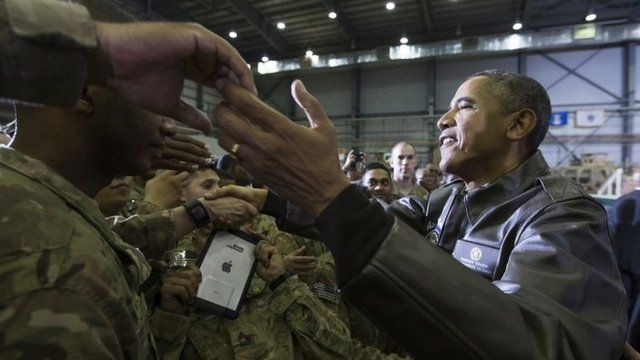 President Barack Obama shakes hands at a troop rally at Bagram Air Field, north of Kabul, Afghanistan, during an unannounced visit, on Sunday, May 25, 2014